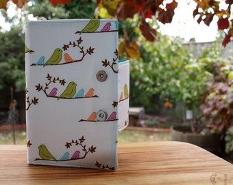 Oversized wallet with multi coloured birds on branches