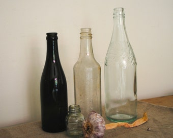 FOUR VINTAGE BOTTLES. Four Vintage glass apothecary bottles. Great antique / vintage collection
