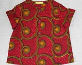 African print baby boy grandad shirt in a bright red and yellow pattern