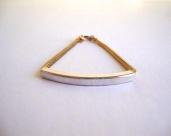 Vintage Trifari Modernist Bracelet: vintage gold and silver tone slider Trifari bracelet