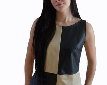 Blue and beige leather waistcoat.