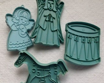 Set of 4 Vintage Blue Hallmark and Stanley Home Product Cookie Cutters