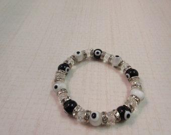 Black, White and crystal clear evil eye beaded bracelet.