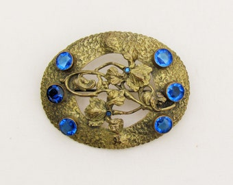 Antique sash pin, early 1900's large brooch with blue rhinestones, oval brass pin with unfoiled stones