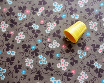 pink and blue flowers on brown vintage cotton fabric -- 36 wide by the yard