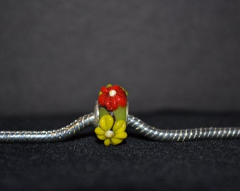 EB-299    European Lime Green Bead with Yellow and Red Raised Flower Detail