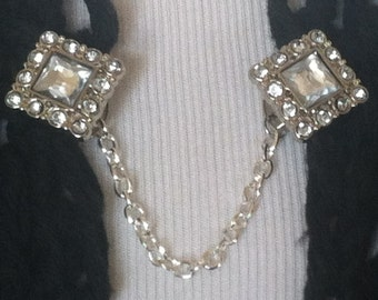 The mattie rhinestone square sweater clip is the perfect touch of sophisticated sparkle for your cover ups.