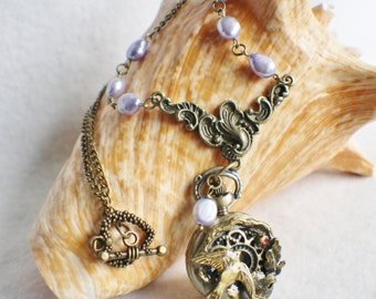 Dove pocket watch pendant with lavender  fresh water pearls and crystal on bronze chain