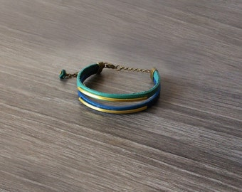 Brass and leather cuff bracelet with metal charms. Blue and green bracelet. Adjustable bracelet