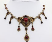 Victorian gothic style necklace set, in dark red and ox brass