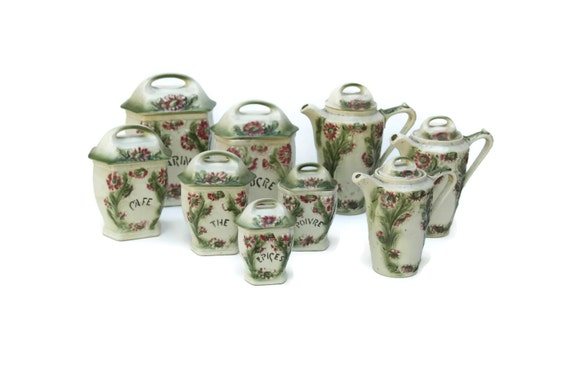 antique majolica kitchen canisters with coffee and teapots