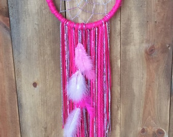 hand woven dreamcatcher with hanging feathers