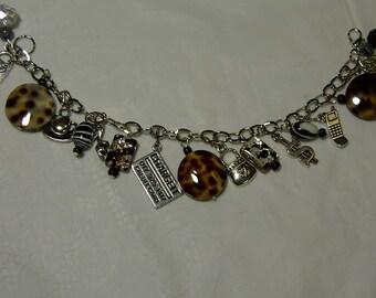"""Cynthia Lynn """"SHOPAHOLIC"""" Rhodium Silver Animal Print Glass Bead Charm Bracelet 7.5"""""""