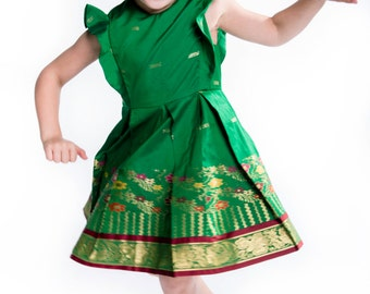 Emerald green girl's dress with box pleats and flower border