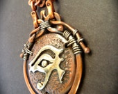 Eye of Horus, Ancient Egyptian Sacred Art,  chunky, classy, hand sawed nickel silver eye & wire wrapped copper, set on copper stippled dome.