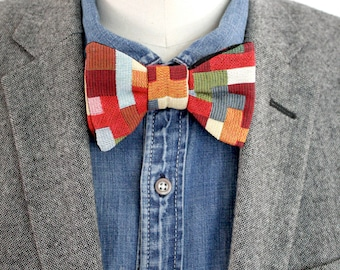 Printed multi-colored square knotted bow tie.