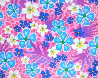 Funky Hawaiian flowers on pink dog bandana slides over the collar