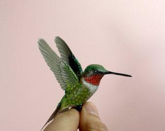 Handmade paper and plastic resin Ruby throated hummingbird.