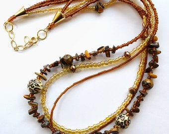 "Multistrand tiger eye and glass ""wild cat"" necklace"