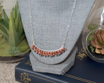 Sparkly dark orange and sterling silver beaded twisted wire necklace | handmade jewelry for charity.