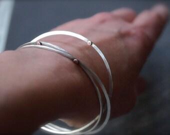 Modern mixed metal sterling silver and 14kt pink gold hammered bangle bracelets