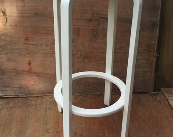 white wooden stool or use as bedside table