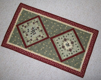 Fall table runner - autumn pine cone leaf topper - small rustic quilted runner - moss green, burgundy red, cream, brown - earth tone colors