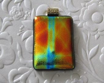 "Dichroic glass pendant - Fused dichroic jewelry - Fused glass pendant - Gold - Green - Blue - Measures 1.5"" x 1"" (approximately)"