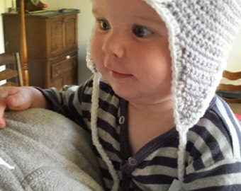 Baby Penguin beanie with earflaps with or without braids.  Girls or boys, any colour combination, newborn to adult.  Easy care, washable