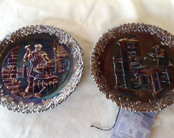 Two Fenton amethyst plates commemorating American craftsmen series, #2 Blacksmith and #3 Printer