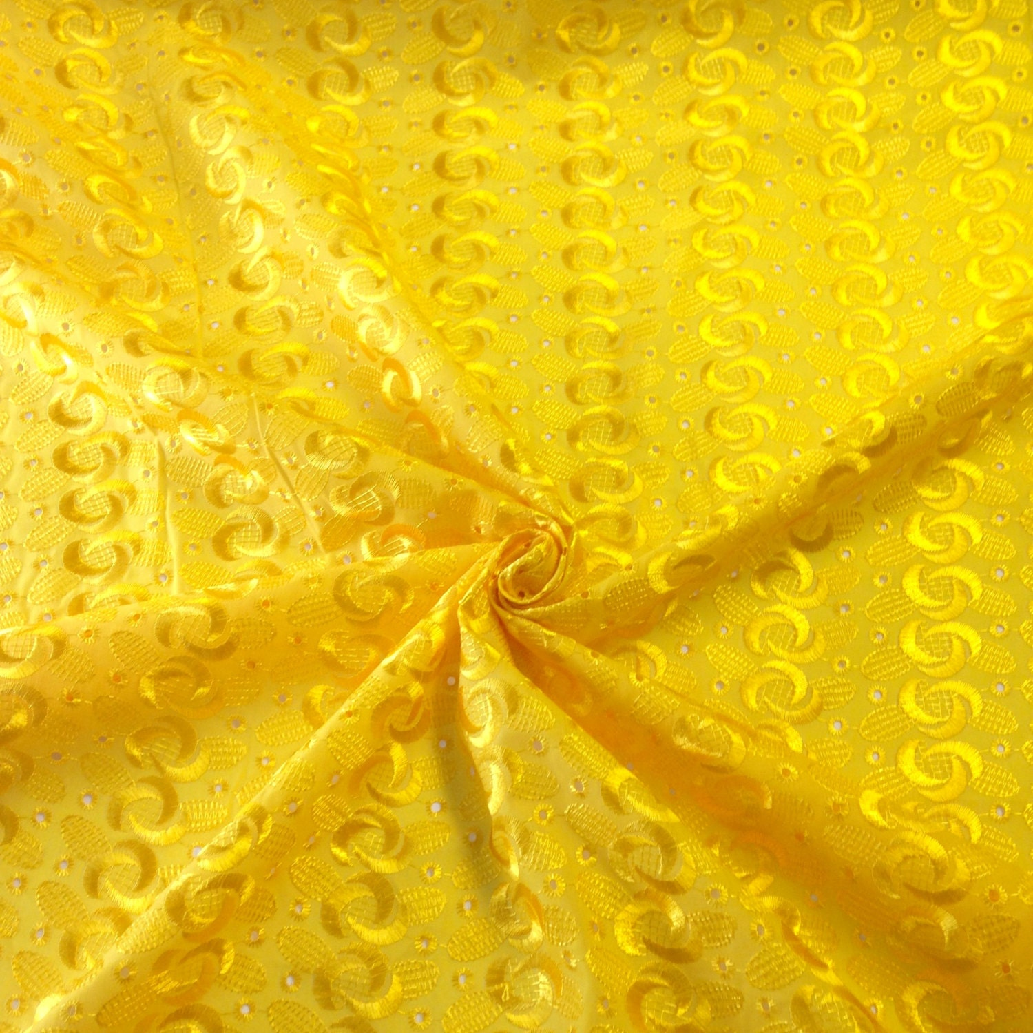 Yellow eyelet spiral embroidery fabric