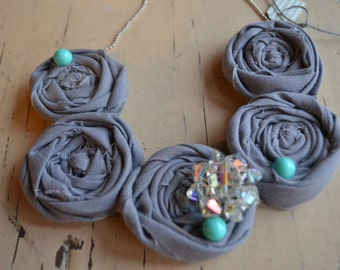 Rosette necklace with vintage jewelry pieces