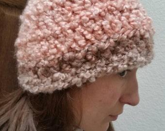 Finger knit hat in peach stripes