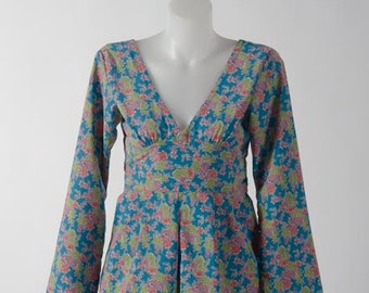 Low V-backed Playsuit with Hanging Sleeves in Blue Flower Power