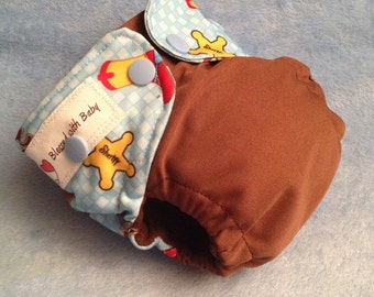 Newborn AIO diaper with snap-in booster