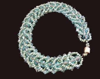 Exquisite! Light green flat spiral stitch bracelet.