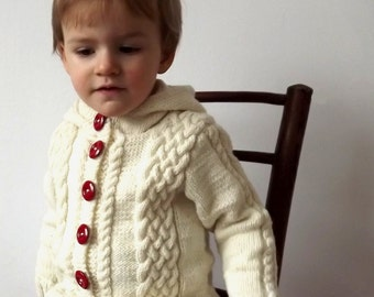 Hand-knitted white baby sweater with hood