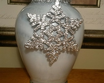 Hand painted silver and blue glass vase with a silver snowflake