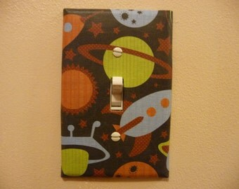 Single switch plate decorated with outer space paper