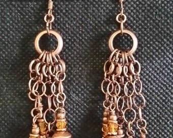 dangling, copper earrings with amber crystals