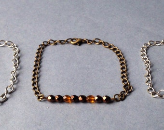 Bracelet adorned with faceted beads maintained by a string.