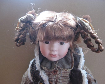 SALE ! Genuine hand painted porcelain doll.
