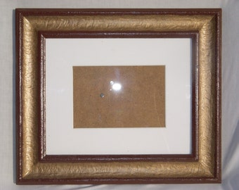 4 x 6 picture and 11.5 x 13.5 frame. 2 toned frame, brown and bronze color