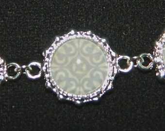 Silver plated bracelet with light blue filigree center