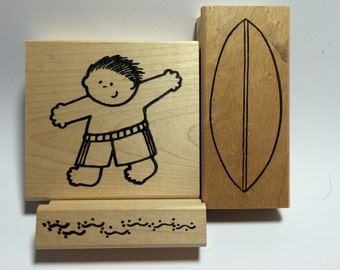Three (3) Rubber Stamps by TAJ of Honolulu:  Surfer Boy, Surfboard, Background Water of Sand Rubber Stamps