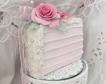 Sweet pink faux cake slice with roses