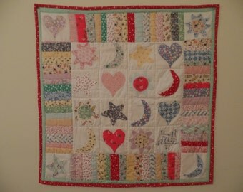 Whimsical 1930's fabric selection. Pastels with machine applique. One of a kind.