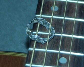 Turks Head Guitar String Ring size 8 1/2.