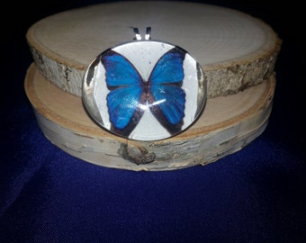 Glass charm with butterfly design