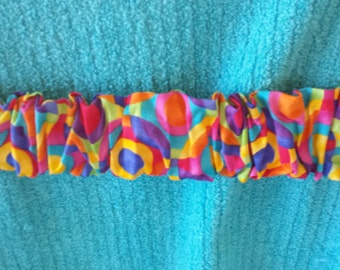Multi Color Beach Towel Scrunchie holds your towel on your chair